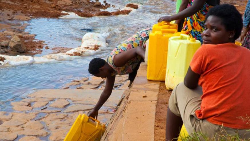 People draw water in Kimisagara, a Kigali City suburb. Recent research shows that about  480 million people in Africa will face water scarcity by 2025. (File)