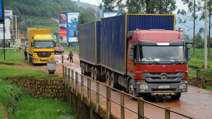 East African cross-border trade is still lagging. Trucks crossing into Rwanda from Uganda at the Gatuna border. (John Mbanda)