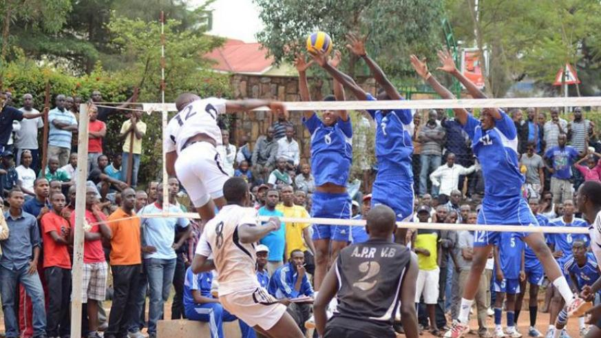 Aimable Mutuyimana (#12) of APR VC spikes against Rayon Sports during the league first round match. File photo