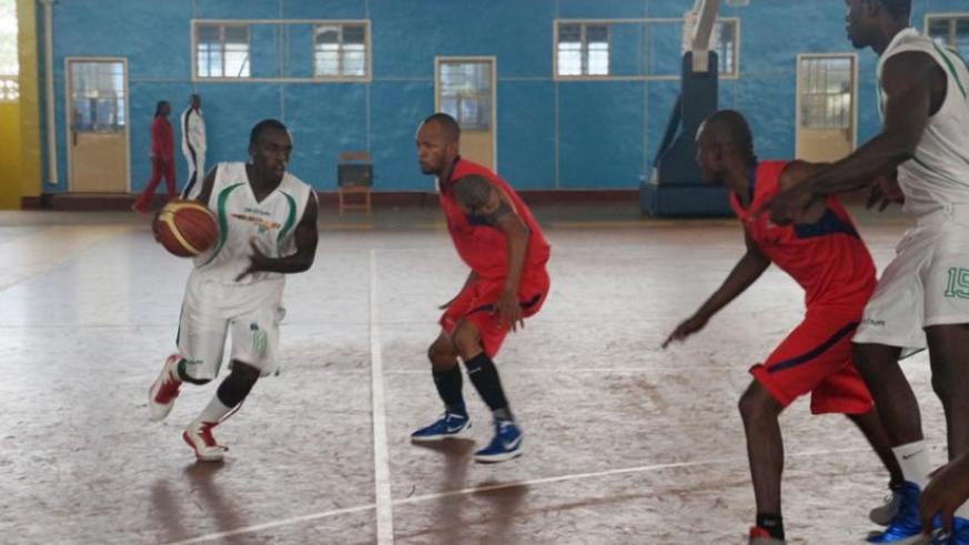 Espoir's Aristide Mugabe, left, dribbles past CSK's Patrick Buzangu during Game Four of the playoffs final played yesterday at Amahoro indoor stadium. (R. Bishumba)