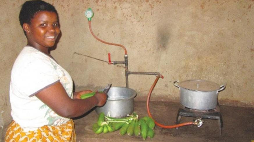A woman prepares food using bio-gas. The RSB is drafting new guidelines to regulate the bio-energy sector.  (Net photo)