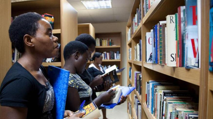 Readers search for books at Kigali Library Services in Kacyiru. (File)