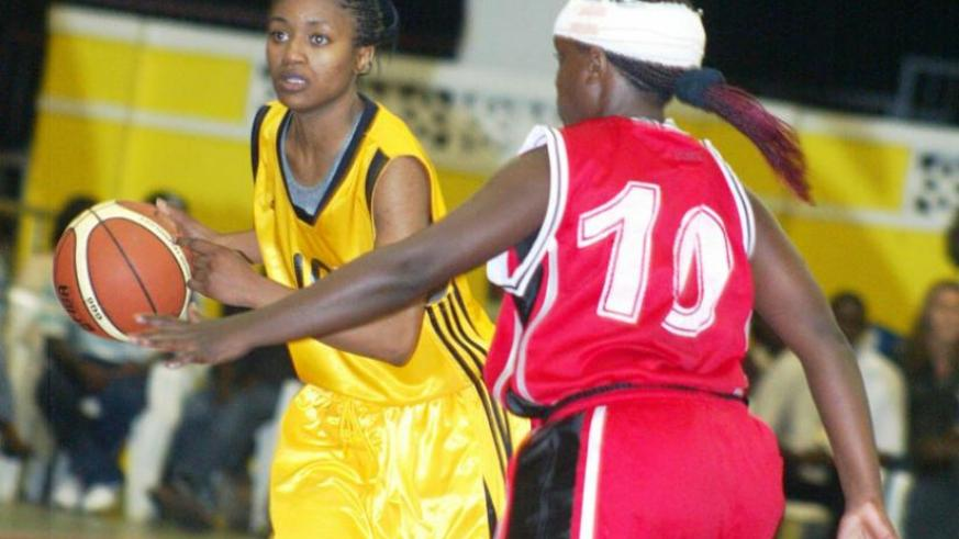 The women's team captain Honore Ayebare, left, seen here playing against Uganda during the 2011 Zove V tourney in Kigali. (File photo)