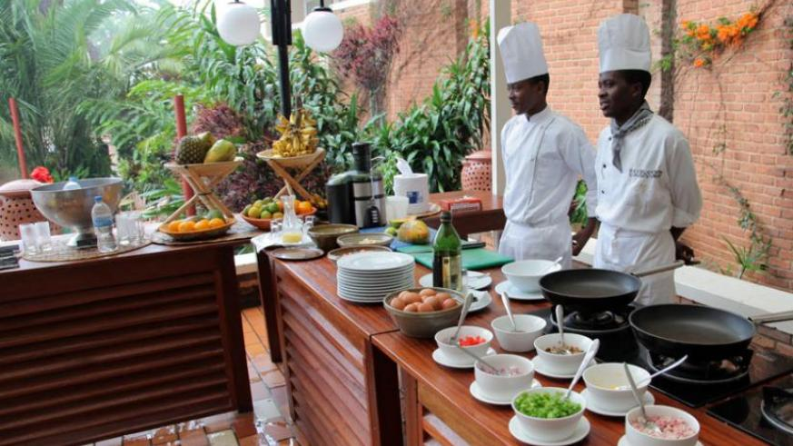 Chefs at Hotel Mille Collines wait to take orders from clients in the recent past.   (John Mbanda)