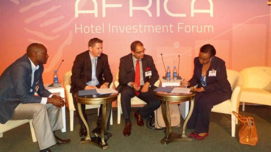 L-R, Benjamin Manzi, director of investment at Rwanda Development Board, Stuart Cook, the MD of Protea Hotels East Africa, Igor Cesar, project manager of Kivu Marina Bay Project, and Amb. Yamina Karitanyi, head of tourism and conservation at RDB, during the signing ceremony in Ethiopia. (Courtesy)