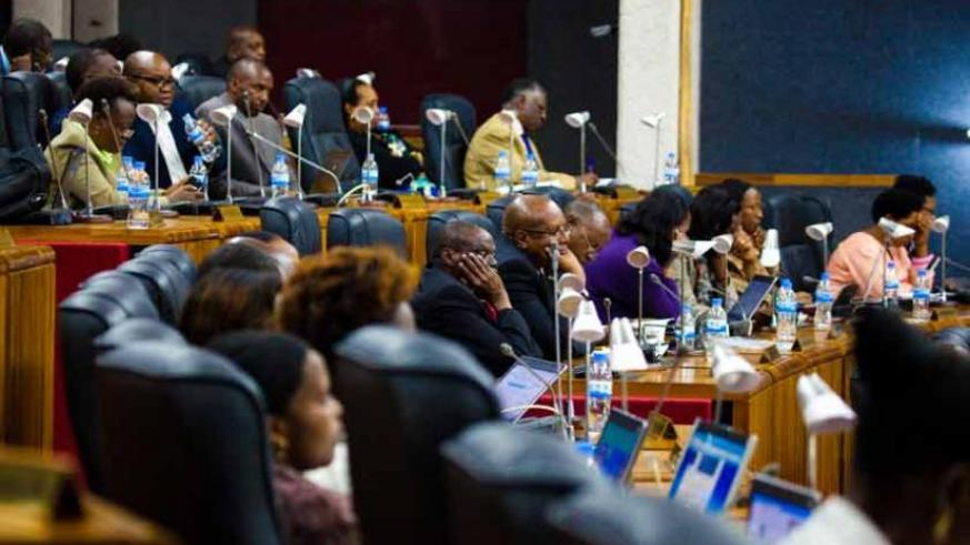 Members of Parliament attend a session earlier this month. (Timothy Kisambira)