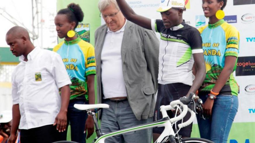 Ndayisenga (second right) won stage two and finished 11th overall. He also the most promising rider award. (John Mbanda)