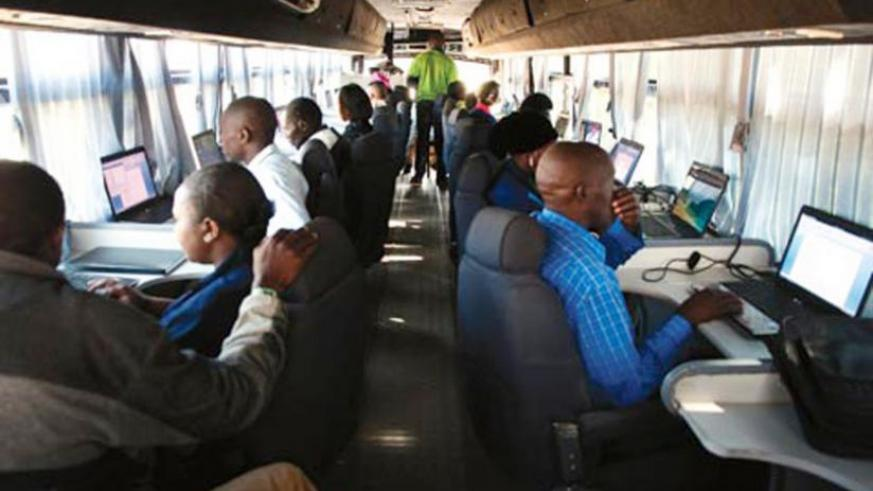 "Rwandans undergoing training on a mobile ""ICT bus"". (File)"