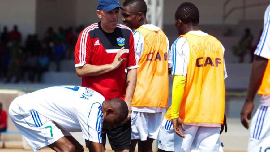 Constantine shares a light moment with his players during a training ahead of the game against Libya in May. (Timothy Kisambira)