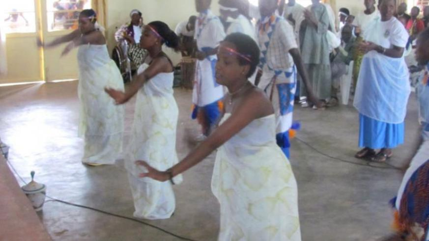 Some of the youth perform traditional dance at the International Day for Older Persons in Huye District on Saturday. The Day featured dances, poems and interactions between older persons and the youth. (Jean Pierre Bucyensenge)