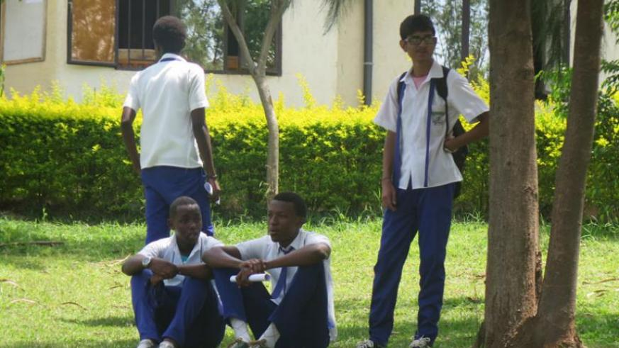 Students relax in the school compound. With a few days to the final exams, every minute counts.  (Solomon Asaba)