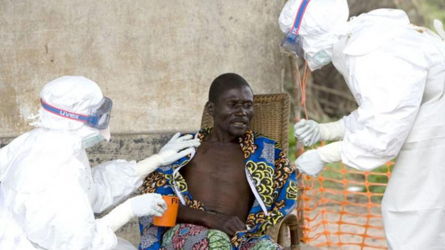 Health workers attend to a suspected Ebola victim in West Africa. The disease is ravaging economies across the continent. (Internet photo)