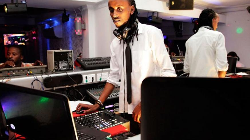 A DeeJay mixes music in a Kigali night club recently. (File)