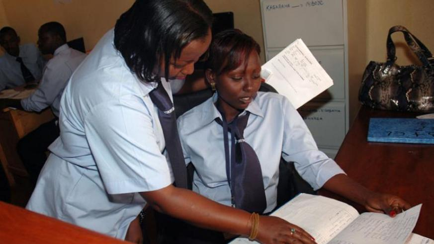 An employee consults a colleague on a work-related issue. Sharing knowledge empowers people and improves communities. (File)