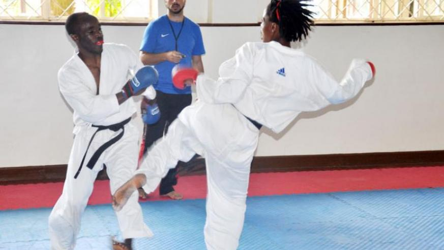 Karate team coach Tamer Abdel-Raouf takes charge of training yesterday. (File)