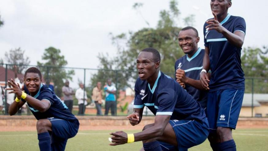 Gabriel Mugabo (C) celebrates with his teammates after scoring Police's fourth goal in the 5-0 win against Kiyovu on Wednesday. (Timothy Kisambira)