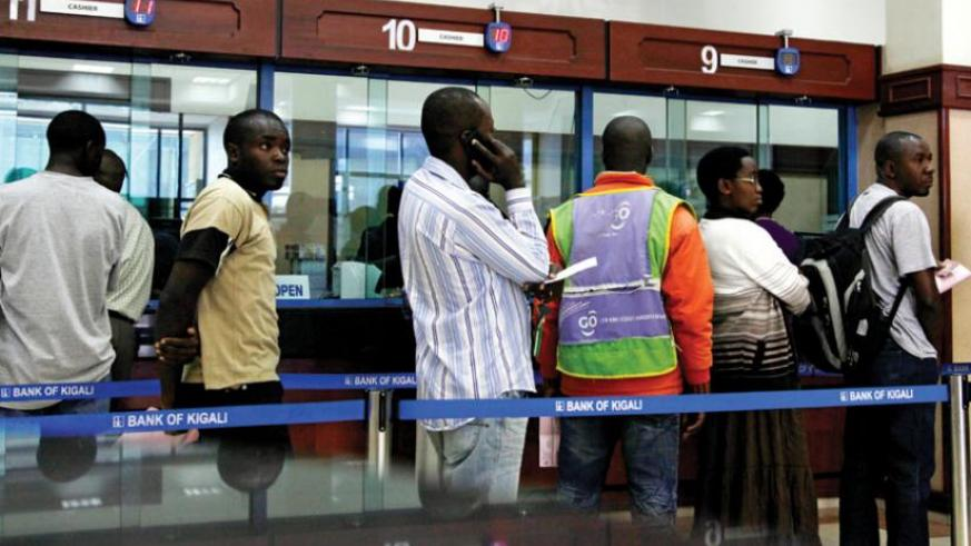 Bank of Kigali customers wait to carry out transactions. ( File)