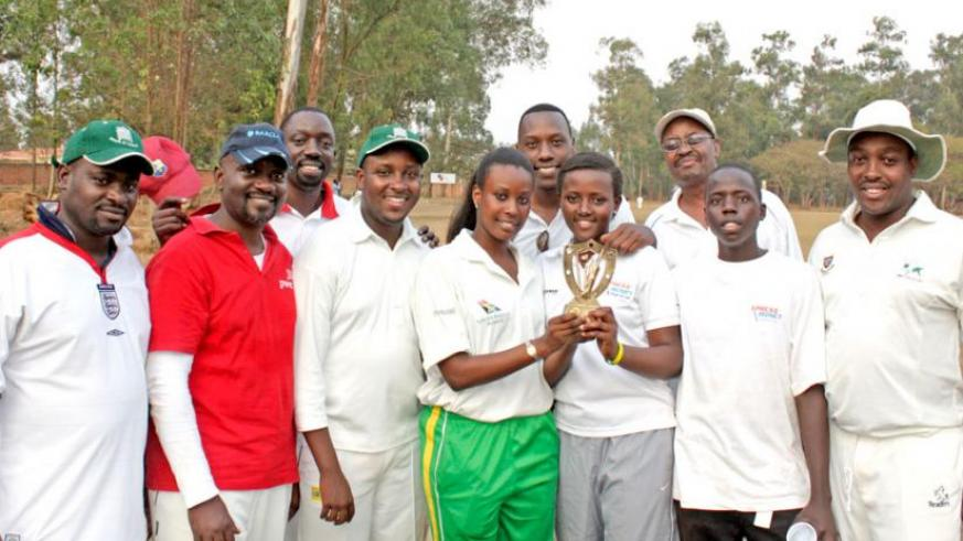 Abakambwe team show off one of the trophies they have won in recent years.