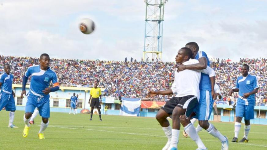 APR's Charles Tibingana (in white) fights for the ball with Abouba Sibomana as Rayon Sports captain Fuadi Ndayisenga (left) looks on during last year's encounter at Amahoro National Stadium. (Timothy Kisambira)