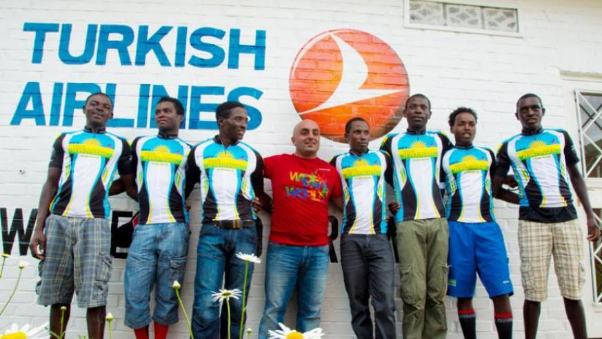 Turkish Airlines country manager Burcin Isler (C) in a group photo with Team Rwanda cyclists. (Timothy Kisambira)