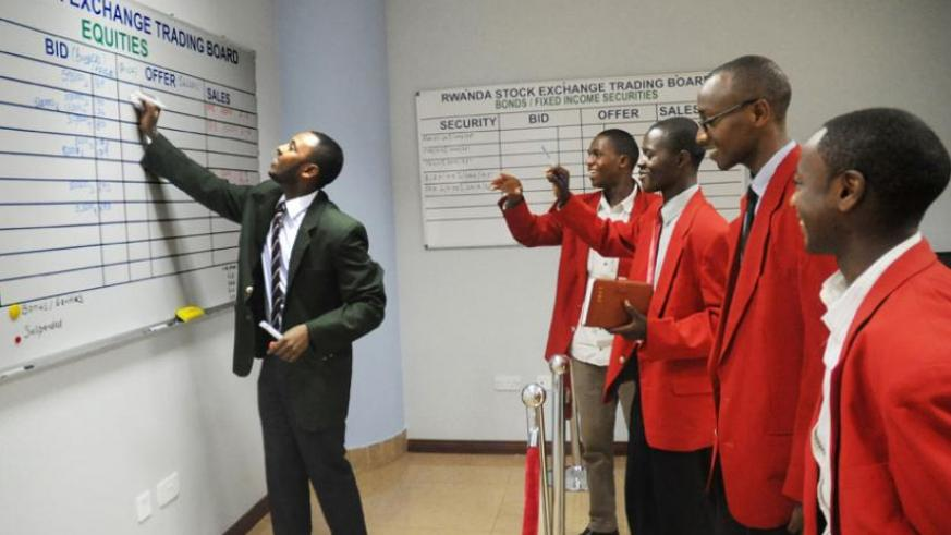 Traders transact business on the floor of the stock market. (File)