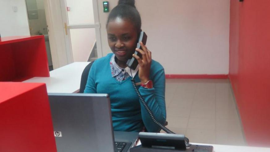 Keza receives an official call at the Airtel head office last week. She has managed to pay for her education courtesy of this job. (Pontian Kabeera)