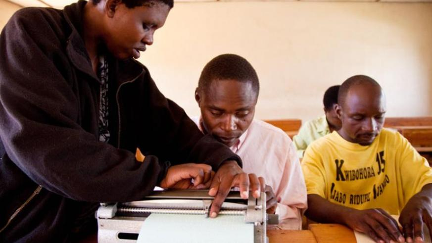 Visually impaired students during a lesson at Masaka School of the Blind in February last year. (T. Kisambira)