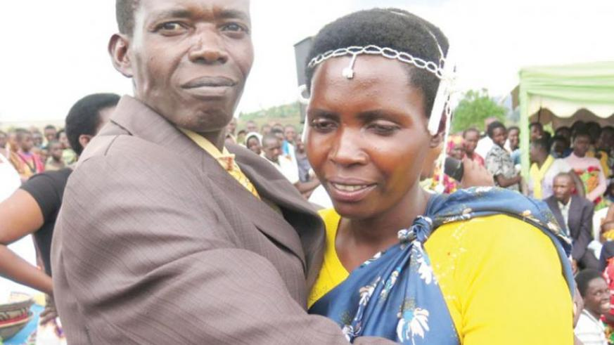 Misago and his wife Mukantabana hug. Their family had been broken by incessant conflicts  but now  they have buried the past and moved on with life. (P. Bucyensenge
