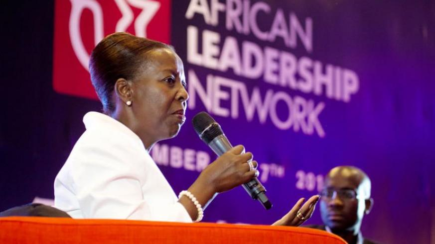 Mushikiwabo (L), together with Aca Leke, one of the founder members of African Leadership Network, during the symposium in Kigali yesterday. (Timothy Kisambira)