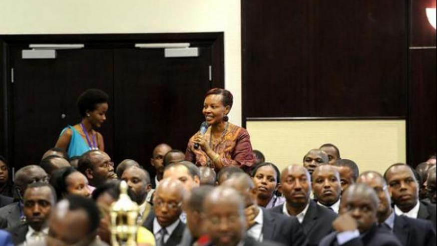 A woman makes a pledge for Agaciro Development Fund during it's launch in Kigali in 2012. (Courtesy)