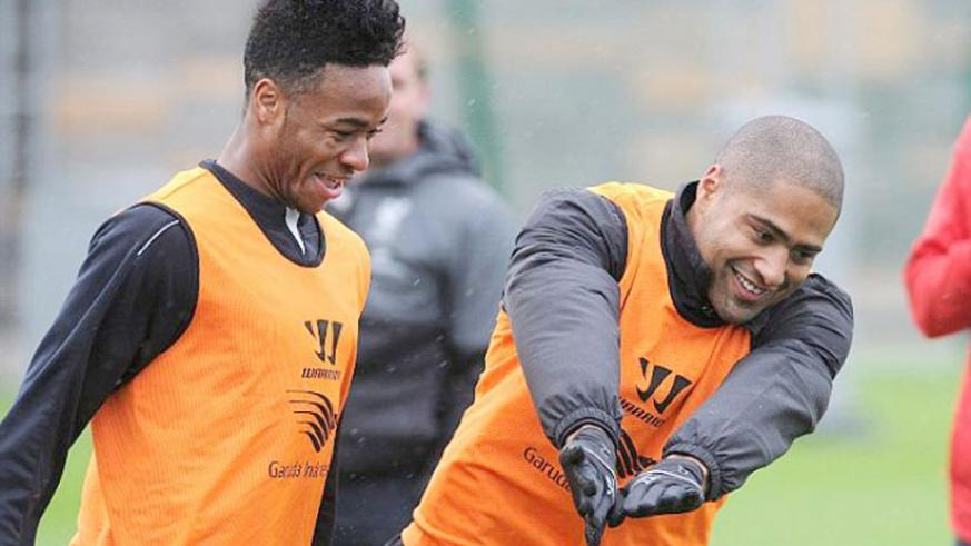 Raheem Sterling (left) and Glen Johnson share a joke as Liverpool prepare to host Jose Mourinho's side. (Internet photo)