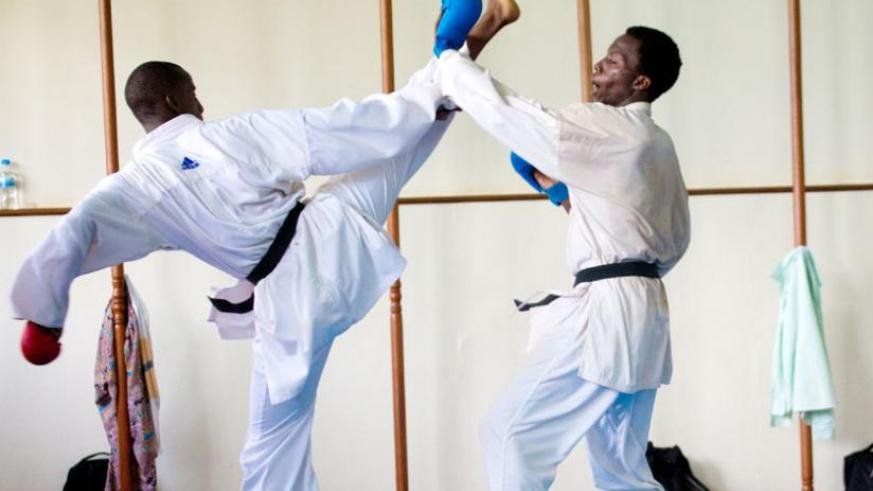 Vanily Ngarambe and Emery Espoir Ntungane were hoping for the best after a three week training stint with Tamer Abdel-Raouf, a highly rated Egyptian Karate coach. (Timothy Kisambira)