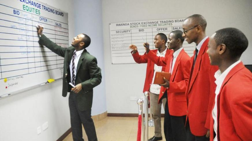 Dealers at the bourse's primary market. Government will issue its third Treasury bond in December. (File photo)