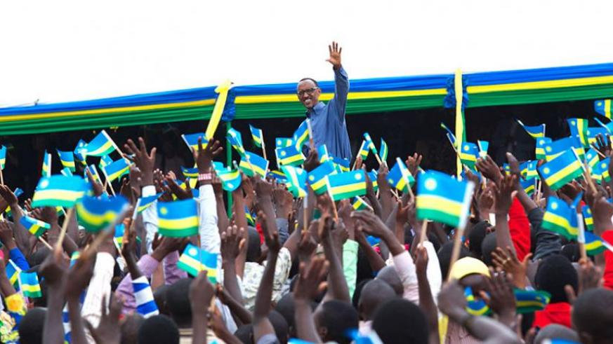President Kagame waves to the crowd in recognition of the warm reception he received at Jabana in Gasabo District yesterday. (Village Urugwiro)