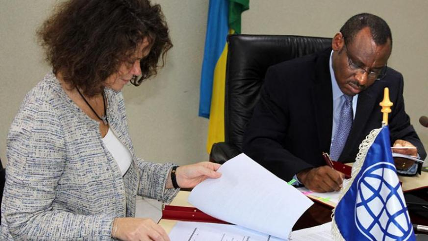 Carolyn Turk (left) and Minister Gatete at the signing of the deal yesterday. (Courtesy)