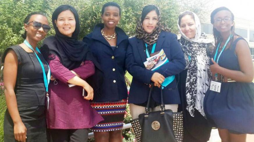Businge (centre) with Rwandan and  Afghanistan women after a summit in the US during the Peace through  Business course.