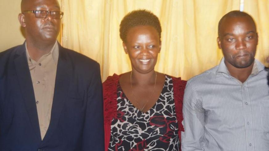 Munyenkusi (right) poses for a group photo with his deputies, Uwamaliya (centre) and Shirimpumpu, after the elections on Tuesday.  (Jean d'Amour Mbonyinshuti)