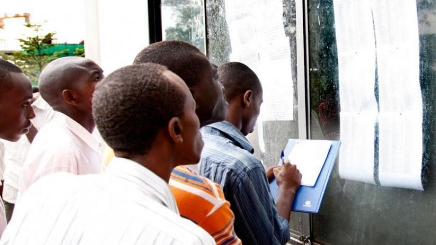 Students at former SFB (now College of Business and Economics) check their marks on the notes board in 2011. (File)