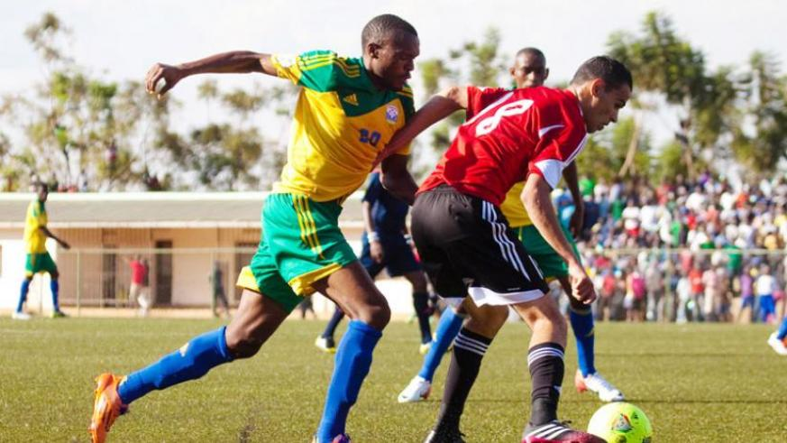 Amavubi striker Jacques Tusiyenge tries to get past a Libya defender in an Afcon qualifier in July. Amavubi players are adamant delayed wages won't affect their performance tomorrow. (File)