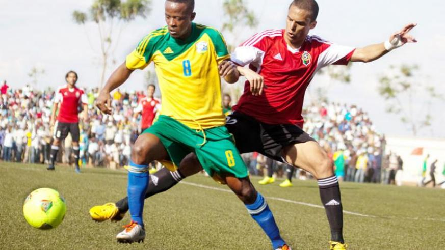 Amavubi captain Haruna Niyonzima takes on a Libyan defender in the 2015 Afcon qualifiers. The midfielder thinks the youthful Amavubi team is good enough to beat Morocco. (File)