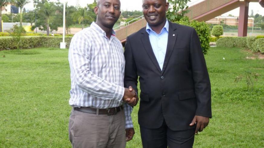 New Rugby Federation President Alex Araire (L) being congratulated  by his predecessor Dr Otto Vianney Muhinda  after being elected for a four-year term last week. (File)