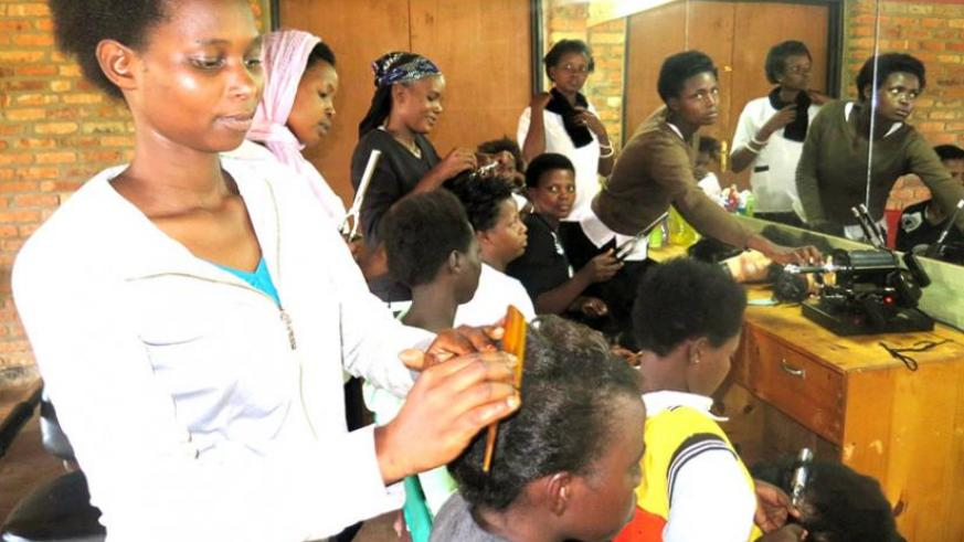 Agnes Uwimana doing hair dressing as part of her training.  (Stephen Rwembeho)