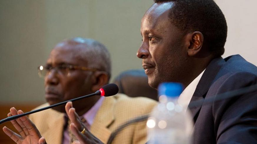 The commission chairperson Martin Ngoga, a former prosecutor-general (R), and member Christophe Mfizi, the dean of the School of Journalism at the Catholic Institute of Kabgayi,  during yesterday's news briefing at Telecom House in Kacyiru yesterday. (Timothy Kisambira)