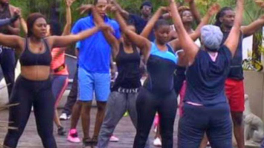 The housemates during a workout routine.