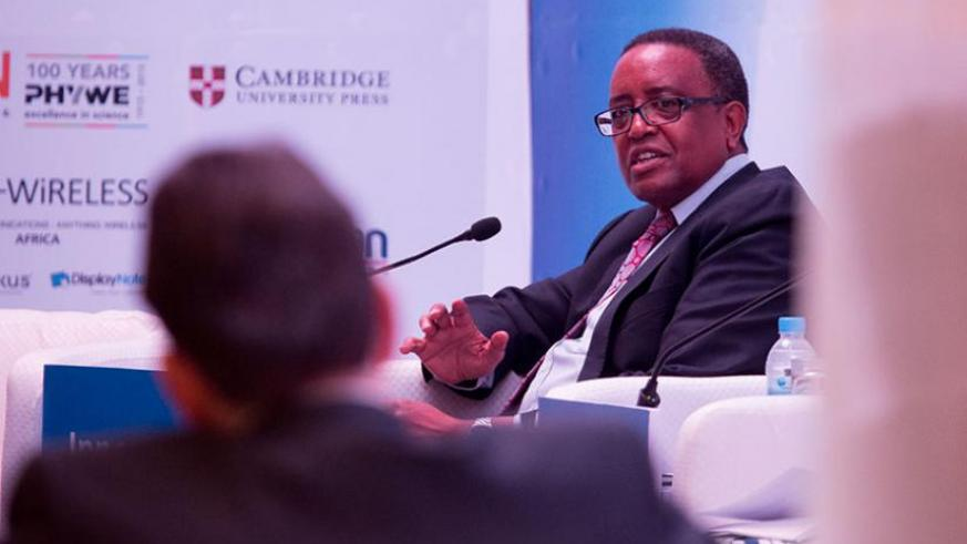 Education minister Prof. Lwakabamba in a discussion during the  Innovation Africa meeting yesterday.(Timothy Kisambira)
