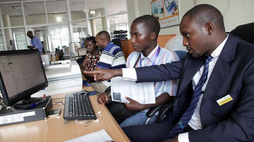 An official at RDB guides a client on how to register a business online. (John Mbanda)