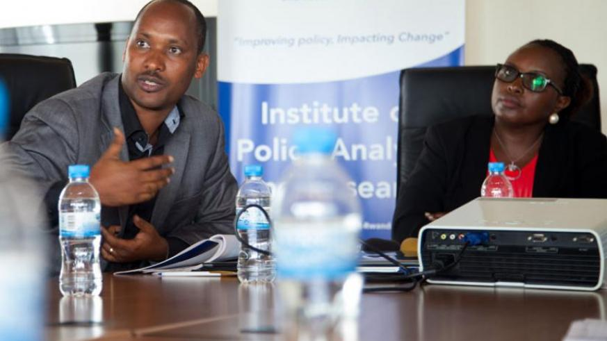 Dr Alfred Bizoza (L), Director of Research IPAR-Rwanda explains to journalists the research findings as Kayitesi looks on yesterday.  (Doreen Umutesi)