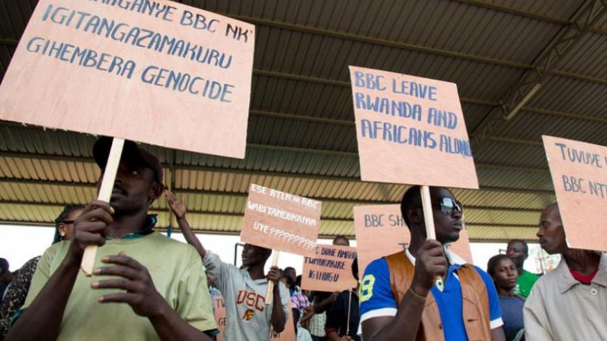 Protesters hold placards at Kicukiro, in a demo against BBC, earlier this month. (Timothy Kisambira)