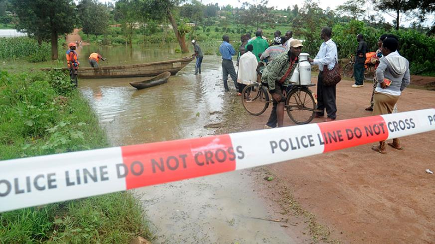 A flooded road in 2012. Such extreme weather conditions will increase as temperatures rise. (File)