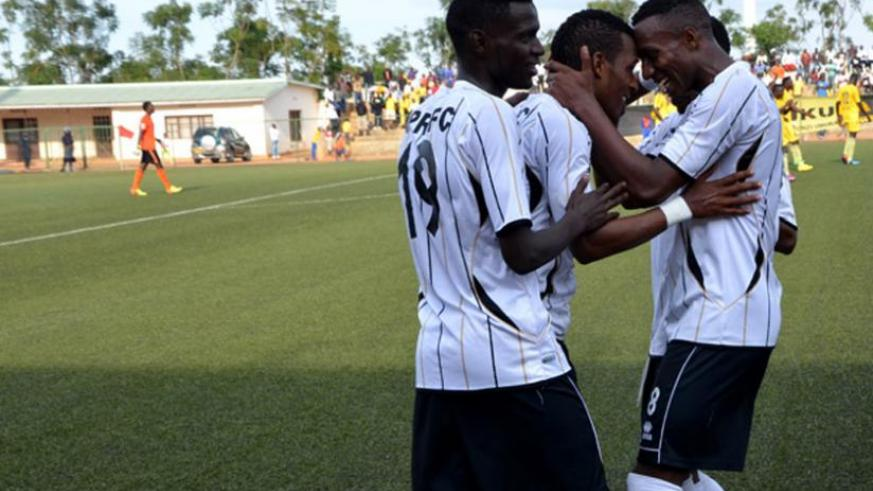 APR players celebrate the first goal scored by striker Patrick Sibomana (M). (Samuel Ngendahimana)